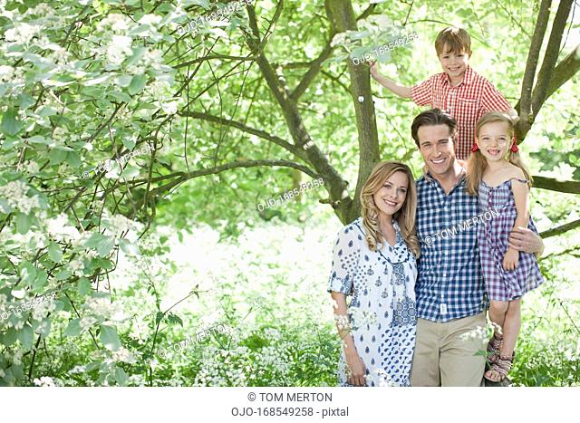 Family standing under tree outdoors