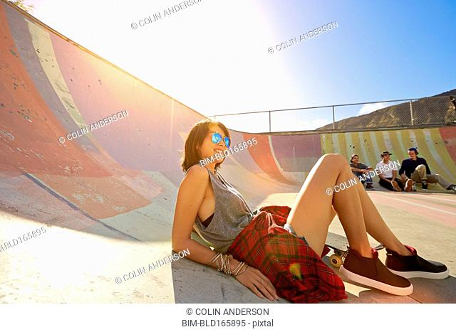 Friends relaxing at skate park