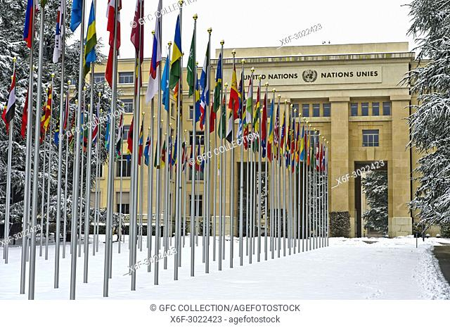 Snowcovered court of flags at the United Nations Office at Geneva, UNO, Palais des Nations, in winter time, Geneva, Switzerland
