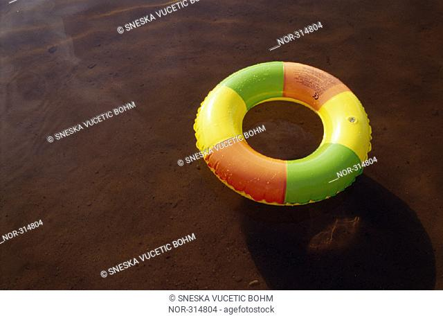 A rubber ring on shallow water