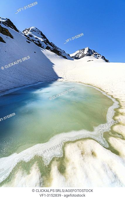 A mountain lake under Sforzellina Peak. Santa Caterina Valfurva, Gavia pass, Lombardy, Italy
