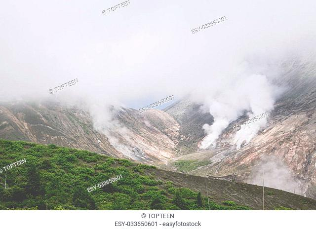 View of Mount Usu summit and fuming volcanic smoke located at the south of lake toya, hokkaido, japan
