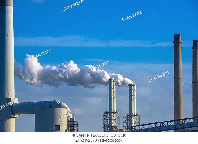 smoking chimneys at industrial plant in holland