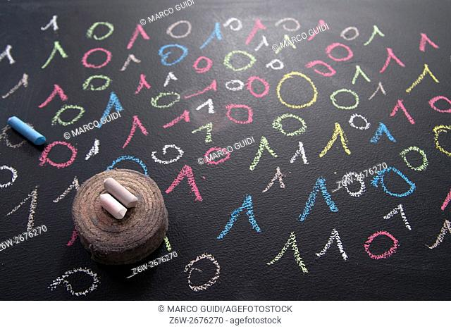 Graphic representation with chalk on blackboard colorful binary code