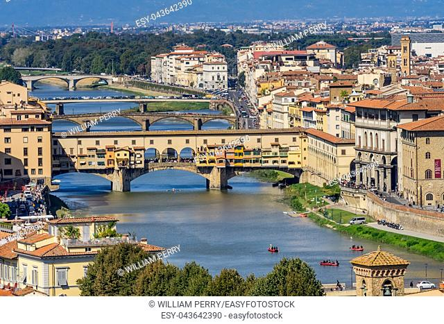 Ponte Vecchio Bridge Reflections Arno River Florence Tuscany Italy. Bridge originally built in Roman times, rebuilt in 1345