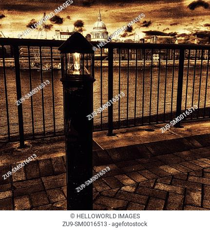 Illuminated lamppost by river Thames opposite St Paul's Cathedral, London, England, Europe