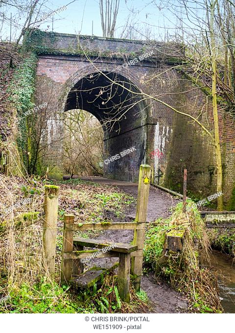 Public footpath under disused railway arch in Cheshire, England, UK