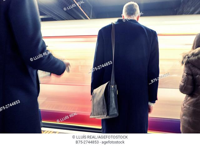 Business people in London Underground. Bank Station, London, England