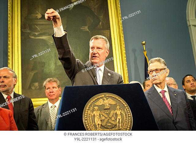 New York Mayor Bill De Blasio, left, and NYS Assembly Speaker Sheldon Silver, right, announce administrative changes to help families of students with...