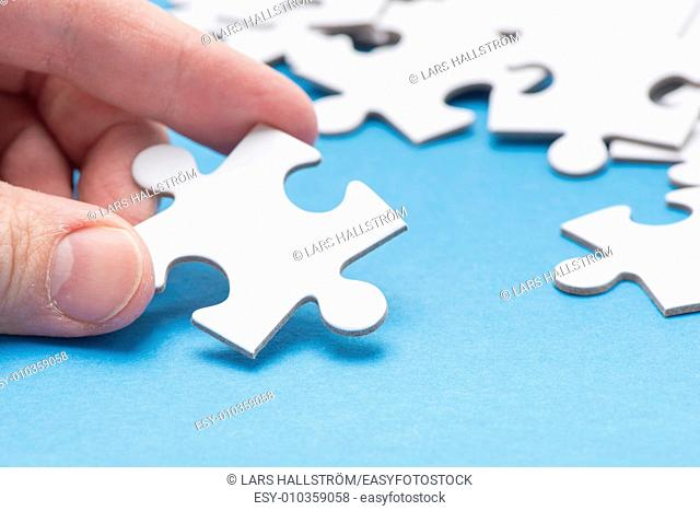 Hands Holding Connected Jigsaw Puzzle Pieces - BerkshireRegion