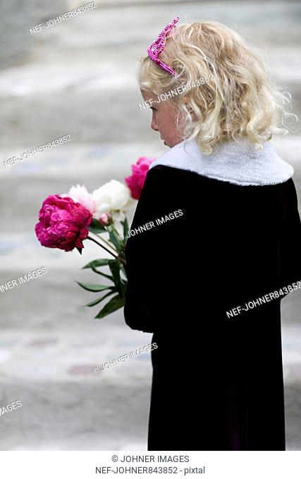Girl in black holding a bouquet of peonies, Sweden
