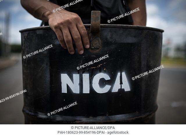 23 June 2018, Nicaragua, Managua: A student stands in the university with a self-made shield. Paramilitaries stormed the National Autonomous Universities of...