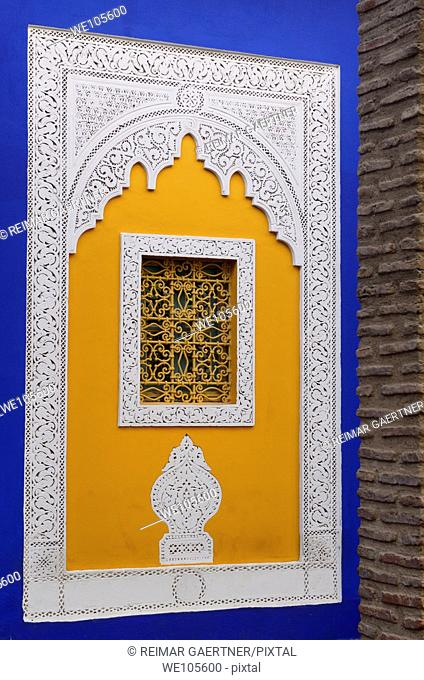 Ornate yellow window at the cobalt blue Islamic Art Museum of Marrakech at Majorelle Garden Morocco
