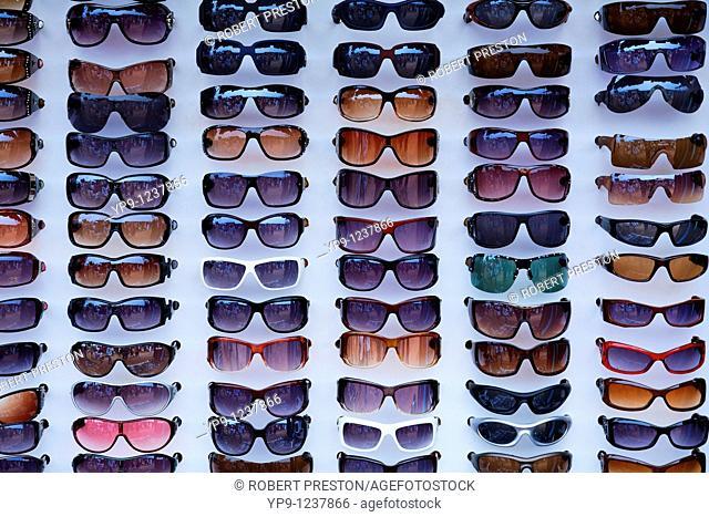 India - Goa - Anjuna Market - display of sunglasses at a market stall