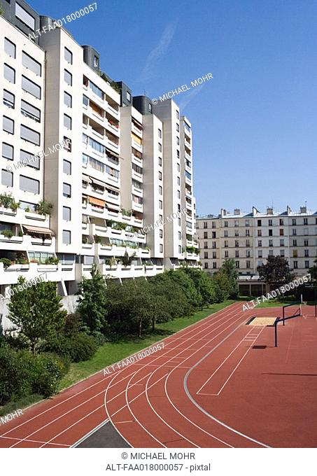 Apartment complex and running track