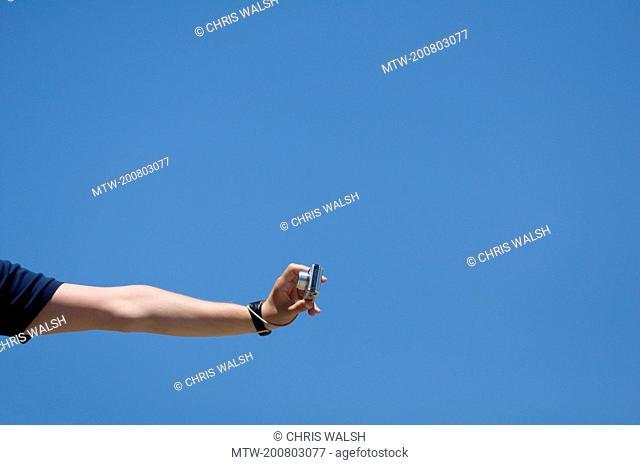 Detail hand holding camera taking photo selfie