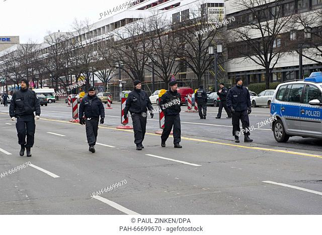 Police officers on Bismarckstrasse in Berlin, Germany, 15 March 2016. Adriver died there, when an explosion occurred in the car while it was moving