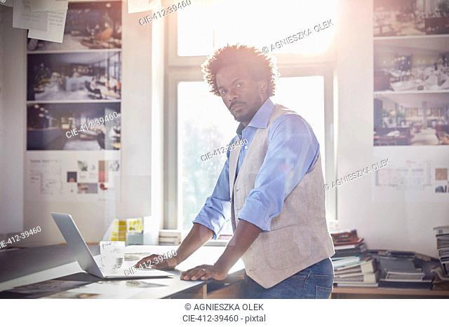 Portrait confident male graphic designer