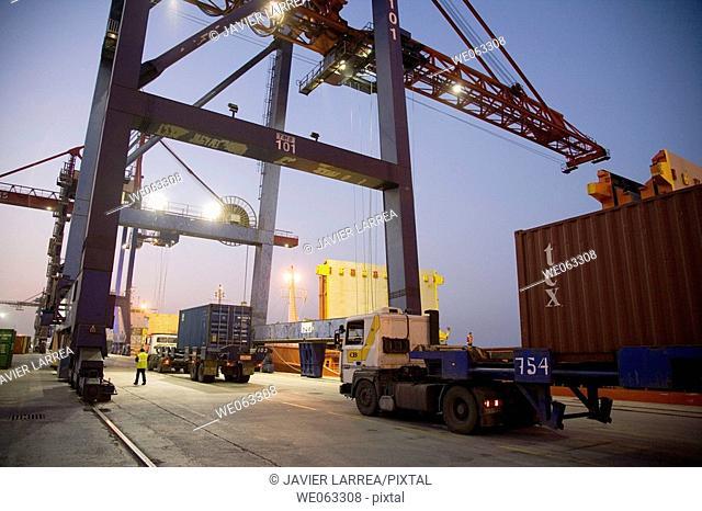 Loading cargo containers in ship, Port of Bilbao, Santurtzi. Biscay, Euskadi, Spain