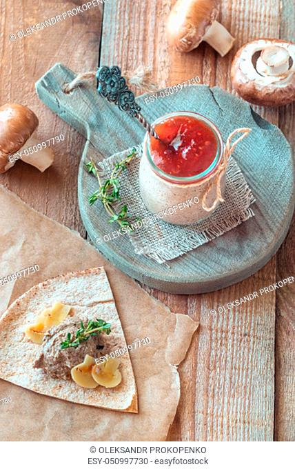 Mushroom pate decorated with with fresh thyme in the glass jar