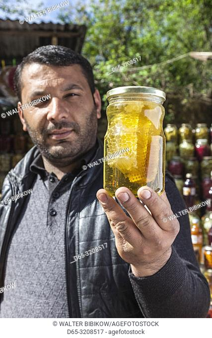 Azerbaijan, Vandam, male vendor with honeycomb, MR