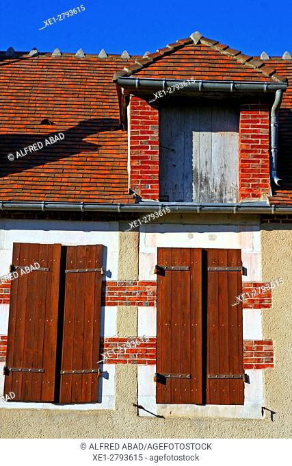 Windows and roof, St Amand en Puisaye, France