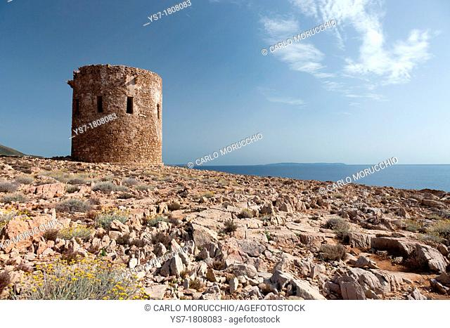 The spanish tower overhanging Cala Domestica beach famous for the green emerald waters, Buggerru, Sardinia, Italy, Europe