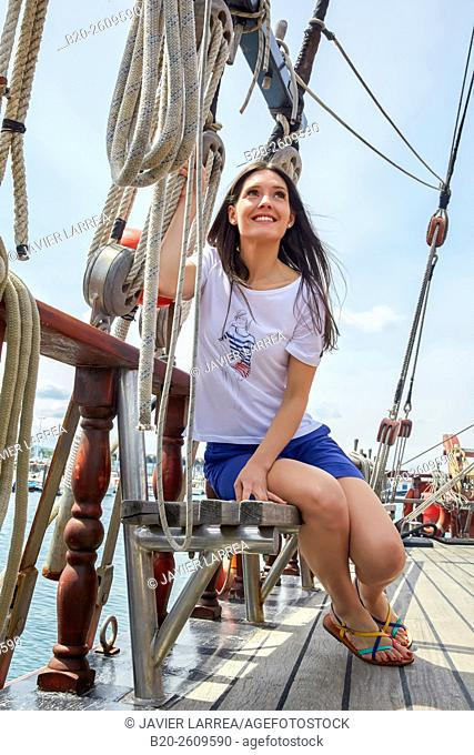 Young woman woman. Ropes sail of a sailboat, galleon. Basque Country. Spain