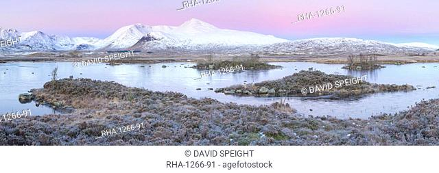 Pink sunrise and snow covered Black Mount from a frozen Lochan-na h'achlaise, Rannoch Moor, Glencoe, Highlands, Scotland, United Kingdom, Europe