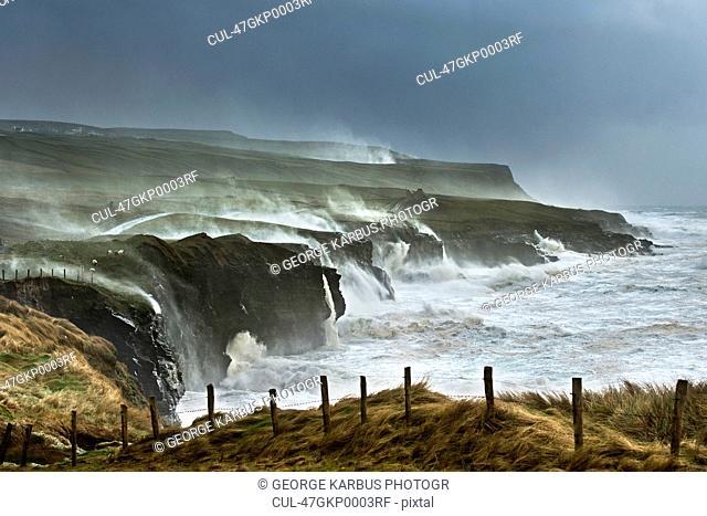 Waves crashing on rocky cliffs