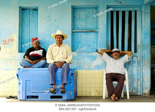 Local men in a small boat gas station in the Centla swamps (Pantanos de Centla) tropical moist forest biosphere reserve, Tabasco, Mexico, America