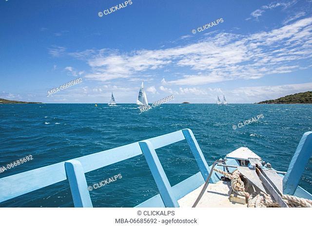 Boats sailing in the turquoise waters of the Caribbean Sea Green Island Antigua and Barbuda Leeward Island West Indies