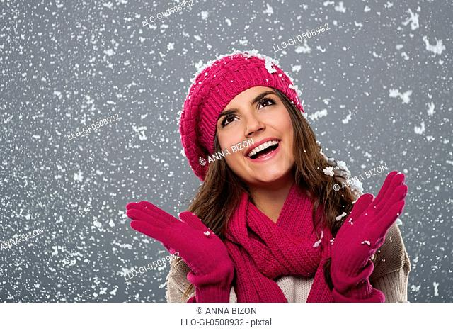 Beautiful woman is happy from snow in winter time Debica, Poland