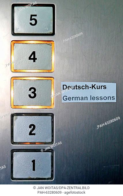 "A sign reads '""""German lessons' in the elevator of an office building in Leipzig, Germany, 2 November 2015. Many German language classes are fully booked due to..."