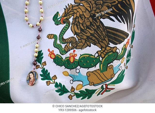 A rosary with the image of Our Lady of Guadalupe decorates a Mexican flag in Mexico City, December 11, 2010  Hundreds of thousands of Mexican pilgrims converged...