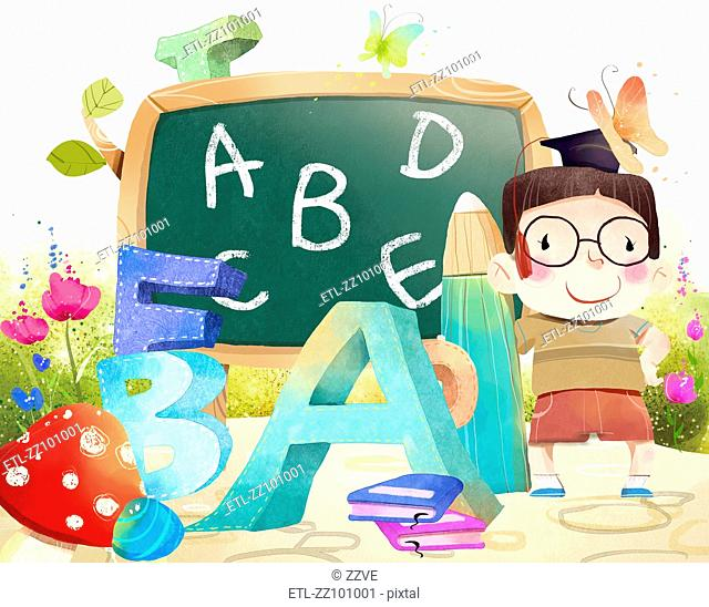 Portrait of boy with Blackboard and Alphabets