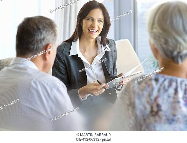 Financial advisor talking to clients in office