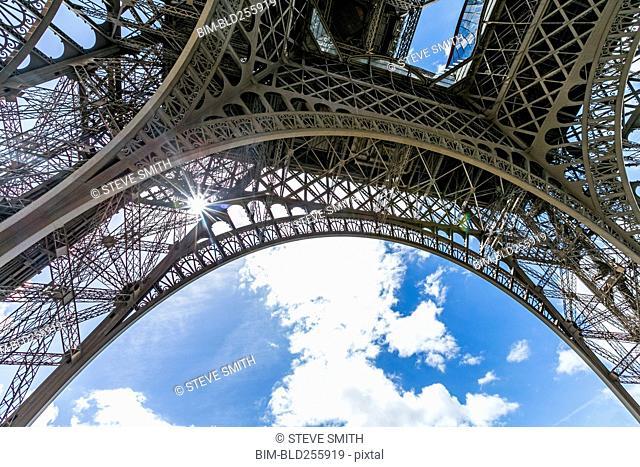 Sunbeams through metal beams of Eiffel Tower, Paris, Ile de France, France