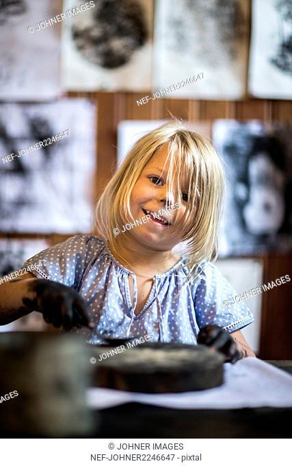 Blond girl during art classes