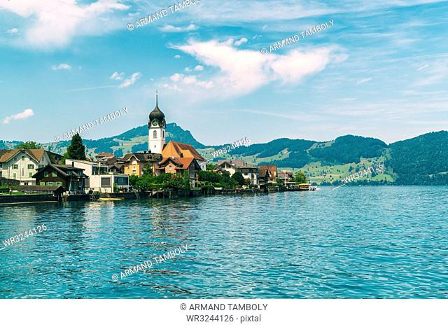 Beckenried village on Lucern Lake with the Catholic church of St. Heinrich seen in the middle, Beckenried, Nidwalden, Switzerland, Europe