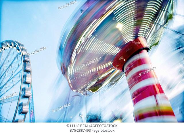 Close-up of Chair Swing ride in motion. Winter Wonderland, Hyde Park, London, UK, Europa
