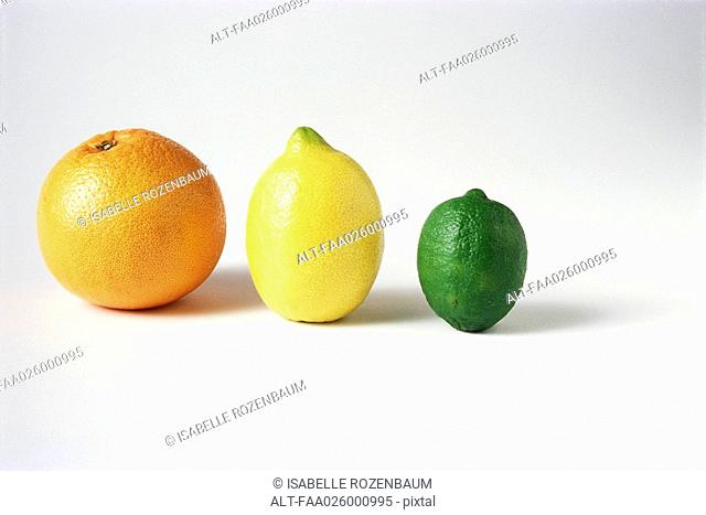 Orange, lemon, and lime in a row, close-up