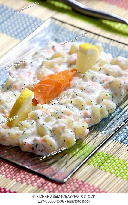 potato halusky (dumplings) with smoked salmon (Slovakian cuisine)