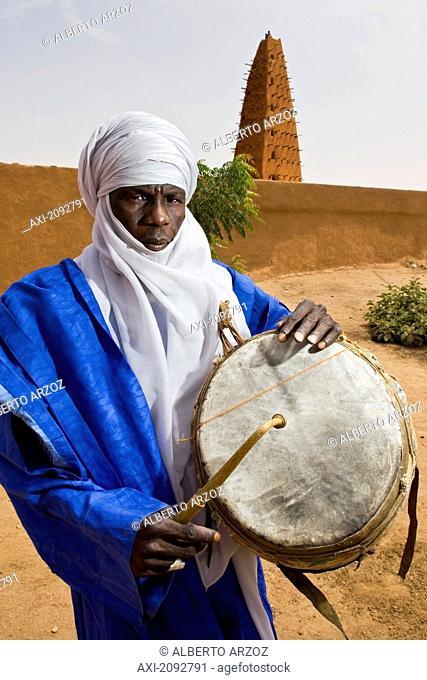 Niger, Sahara Desert, Agadez Region, Tuareg Drummer Standing Next To Agadez Grand Mosque; Agadez