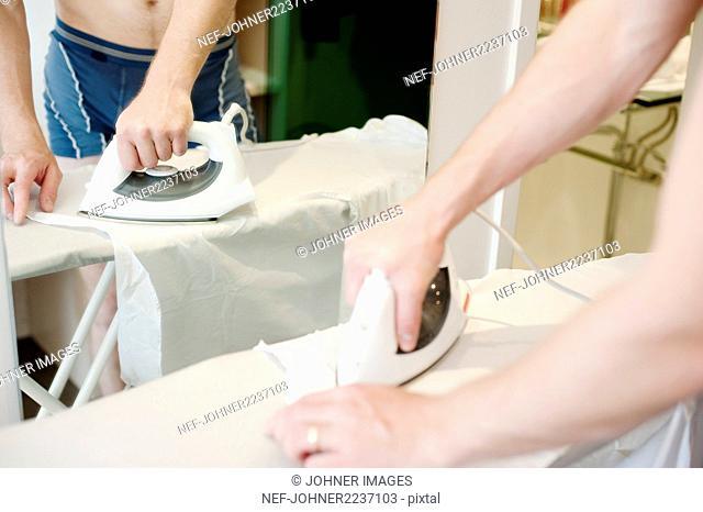 Man ironing, close-up