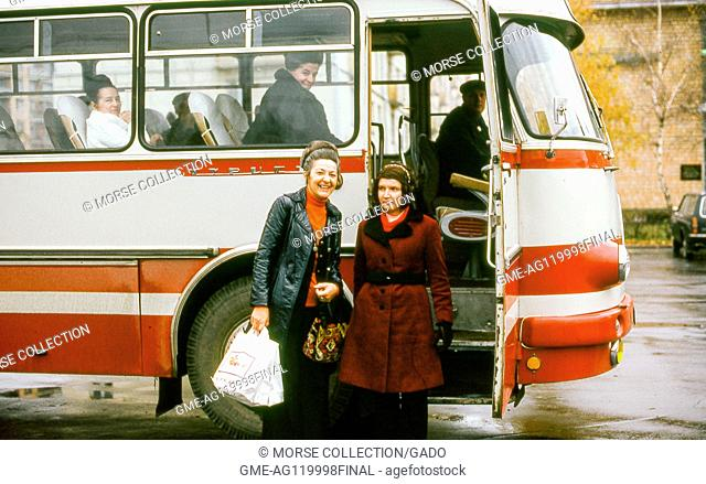View of Western women tourists posing for the camera before boarding their tour bus in Moscow, Russia, Soviet Union (USSR), November, 1973
