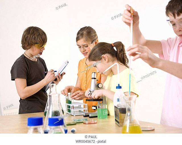 Students doing experiment in chemistry laboratory