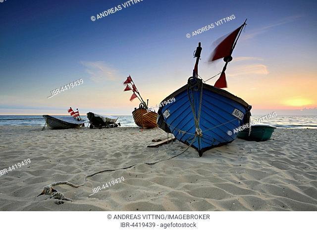 Fishing boats on beach at sunrise, Kölpinsee, Usedom, Mecklenburg-Western Pomerania, Germany