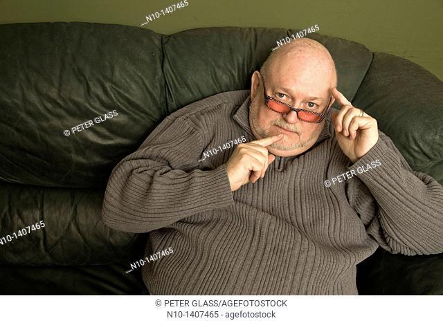 Older man wearing sunglasses
