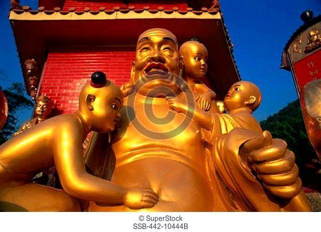 Low angle view of statues of Buddha, Ten Thousand Buddhas Monastery, Sha Tin, New Territories, Hong Kong, China